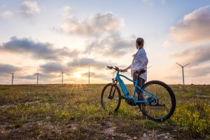 Woman with a bike in the nature