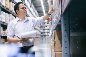 Man warehouse worker checking stock.